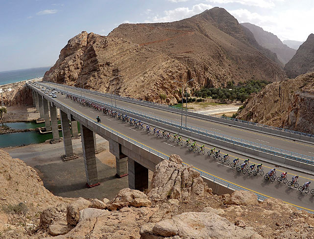 A pack of riders make their way through the second stage of the Tour of Oman cycling race between Sur and Wadi Dayqah Dam, Oman. (EPA) MURPHY: Feds case may be closed, but Armstrong not yet in clear