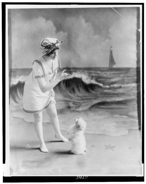 mnemotherapy:  Young woman and cute little dog, 1913