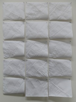 15 Pieces of A5 Paper, Rolled, Folded, Unfolded, Unrolled and Pinned to a Wall, 2012 Paper and Pins