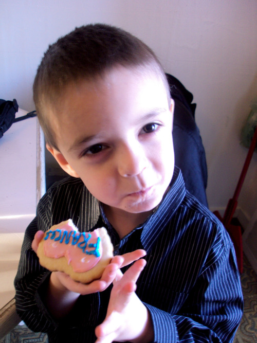 My little boy Francis eating the Valentine's Day cookie I made for him. He even dressed up. When I picked him up from school he was wearing a dress shirt, slacks and a belt. When his dad came to get him, I was told that Francis chose to wear this to make me happy. I fuckin' love that kid.