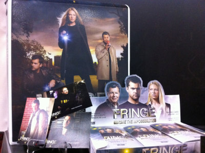 iwontfakeit:  Fringe Collectors Cards It's hard to come by any Fringe swag out there, so it's a delight to see Cryptozoic Entertainment providing fans with a Walter, Peter, Olivia and company fix with their new line of collectible cards covering seasons one and two of the sci-fi drama.  The cards will be sold in individual blind packs or boxes with separate packs and might contain cast autograph cards or costume cards featuring fabric from clothing worn by the actors in the show (cards hit comic book and collectible stores in March 2012).