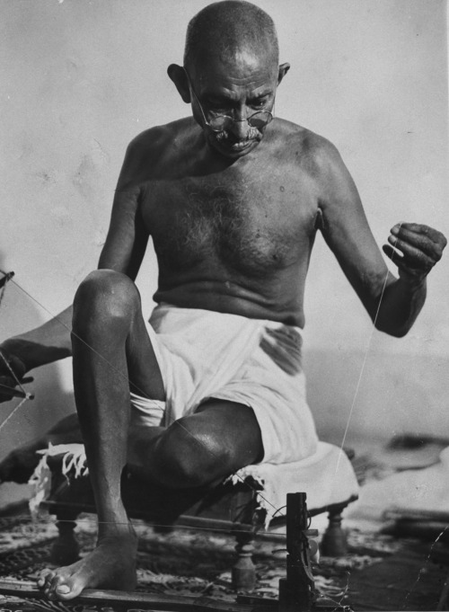 "burnedshoes:  Happy Birthday Mohandas Karamchand ""Mahatma"" Gandhi! Thanks to Julia for reminding me! ""Live as if you were to die tomorrow. Learn as if you were to live forever."" (Mahatma Gandhi)  © Margaret Bourke-White, 1946, Mohandas Karamchand Gandhi working at a spinning wheel The spinning wheel, a device used to make yarn or thread came to symbolize the notion of Indian self-sufficiency — and thus independence from British rule. This symbolism is also part of the Flag of India:     © India Post, The first stamp of independent India, released on 21 Nov 1947 Before Margaret Bourke-White was allowed to photograph Gandhi, she was informed she would need to learn the spinning wheel - it's said that she caught on quickly. She was a friend to Mohandas Karamchand Gandhi; in fact, she was the last person to interview him hours before his assassination in January 1948. It's hardly surprising, really, that Bourke-White would be drawn to a figure like Gandhi. After all, for her entire career, she focused her lens on the human side of any issue — no matter how brutal or unsettling the subject matter — and Gandhi's emphasis on liberty and dignity in the face of savage resistance spoke directly to her own passion for both justice and for adventure. (similar post 