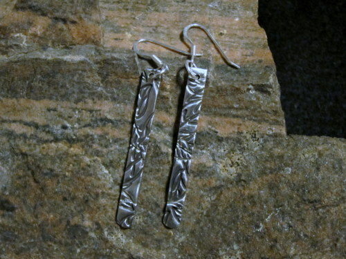 Long silver earrings, textured and polished to high shine. I can make a pair like this to order…. see my listing on on Etsy: http://www.etsy.com/listing/93154314/long-silver-earrings-textured-and