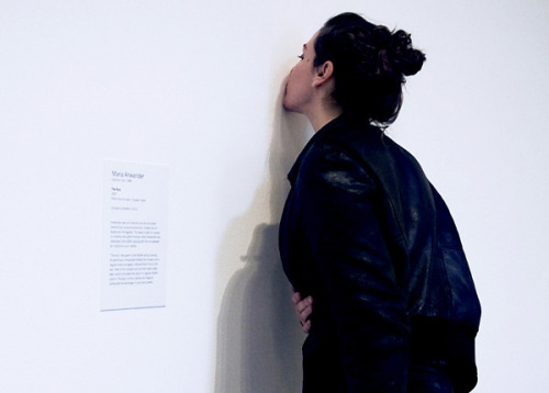 """tat-art:The Kiss - Maria Anwander""""The Kiss"""" was given to the MoMA as a donation without asking for permission. I entered the museum as a regular visitor and gave an intense French kiss to the wall. Next to the invisible kiss I then fixed a fake label, which simulated the style of a regular MoMA caption."""