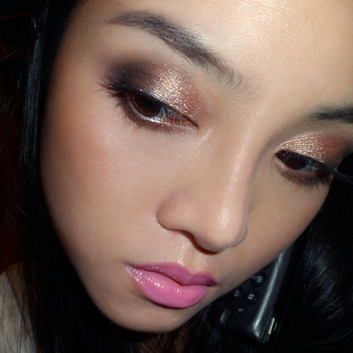 MAC Tan Pigment and Flashtrack Shadow: Bronze and Navy Eye Makeup (for work) —- This was a super-simple eye that looks quite dressy without much effort. I applied Flashtrack (deep navy Veluxe Pearl) to the outer halves of the lids, packing it in a more concentrated way around the socket line. Then I applied Tan pigment (warm peachy-bronze) to the entire lid, blending into the navy. I ran Flashtrack along the upper lash line lightly as a soft definer, using a flat angled brush, then applied mascara. On the cheeks: MAC MSF in Medium Dark (contour) and MAC MSF in Porcelain Pink on cheeks (this was limited edition but you can use any pink/peach mineral blush for a similar effect) On the lips: Revlon Colorburst Lip Butter in Strawberry Shortcake (this is one of my rare non-opaque lip days) —- Side-note: I'm sorry I always take pictures while on conference calls… it's the only time I can do it in the morning! LOL.