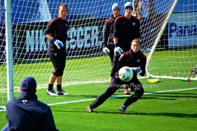 Hope Solo makes a save during goalkeeper practice as USWNT keepers Jill Loyden, Ashlyn Harris & Nicole Barnhart wait for their turn.
