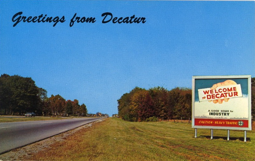 "A GOOD HOME FOR INDUSTRY GREETINGS FROM DECATUR  Decatur, Alabama This sign on U.S. 31 south welcomes visitors and industry to Decatur, the ""Hub of the Tennessee Valley""."