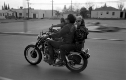 """Buzzard, one of the original San Berdoo Hells Angels, flashes by as his Old Lady flips me the bird, probably the one gesture that sums up the attitude and contempt the Angels had for the outside world."" –photograph by Bill Ray Read more…"