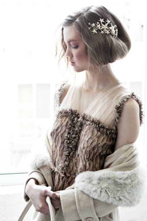 Feathered: Lindsey Wixson backstage at Rodarte Fall 2012