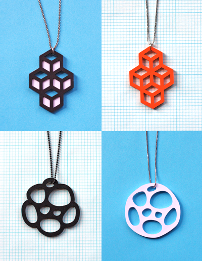 Cut Paper Pendants | How About Orange Something I've been meaning to tell y'all about for ages is my dad's cutting machine. It's like an industrial version of the Silhouette machine. If you've never heard of a Silhouette, it looks like a laminator but it has a blade underneath. You can cut paper, card, vinyl and fabric. It is so so fun to use and there are so many uses for it. As soon as I saw this project, I emailed it to my Dad and said - can we do this?! You just need to cut multiples of your desired shape and glue them together - once it's dried it's hard and you can attach the jump ring for the necklace.