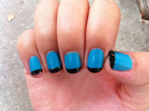 Matte LA Girl turquoise with glitter black tips done with scotch tape.