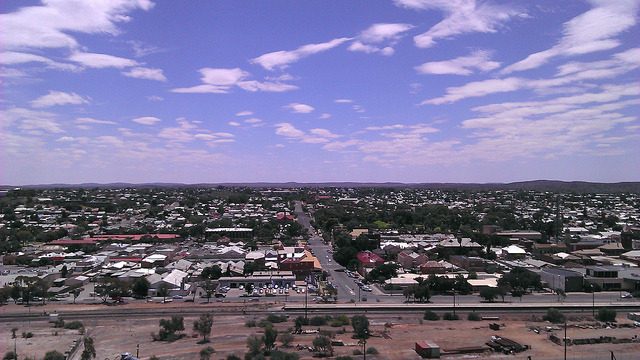 Broken Hill on Flickr. Broken Hill, desert town. Looking north from the top of a slag pile. I got to visit Broken Hill for a day for work. I spent most of my air in an office, which was kind of good as it was 35 that day, far too hot for a pale skinned weakling like myself. But I did get a mini tour of the town and had lunch in a cafe built on top of an old mining slag pile.   The Broken Cafe sits on an old pile of slag, which is both slightly amusing a little worrying, in case the pile of bits of stuff left from mining decides to stop just sitting still and wants to try moving around a bit. Next to the cafe was a bit red bench.  No one knew why the bench was there or how long it had been there or who made it. It's just there. The rest of my trip was spent in airports planes and taxis. In three days I caught six airplanes and seven taxis. At least I got to do a bit of reading. I'd like to go back and spend more time in Broken Hill some time. Though maybe not in summer.