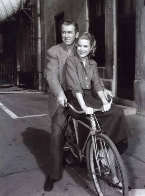ridesabike:  James Stewart and Grace Kelly ride a bike.