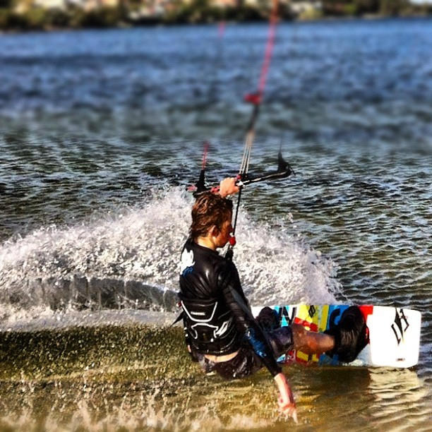 The young bloke kite surfing earlier #surfing #water #sports #iphoneography #pinoy #jimcaro #blogbastic #perth #boy (Taken with instagram)