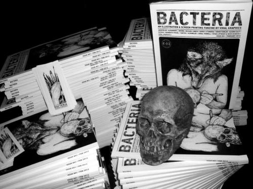 Bacteria issue #1:  -black and white -90 pages/130gr paper (each 'zine is about 0.450kg in weight) -22x32cm (slightly larger than A4) -pro-printed -limited to 150 -each issue hand-numbered & uniquely customized -1 sticker included per 'zine.  Bacteria is an illustration art 'zine created by Viral Graphics, focusing on hand drawn art and illustration.  The first issue features interviews and tons of artwork (almost 80 full pages of art) by some of our favorite artists: Angryblue, Alexander L. Brown, Michael Canich, David V. D'Andrea, Simon Fowler, Alison Lilly, Putrid, Rainbath Visual, Santos Illustration, Glyn Smith aka Scrawled, Jeral Tidwell and an interview with Ryan Lipynsky of Unearthly Trance and Nick Sciacca (talking about the artwork on all things Ryan Lipynsky has recorded as Thralldom/Unearthly Trance and Howling Wind).  Each copy will be customized differently, with a small unique original illustration by us on the back.   Available here:  http://viralgraphics.bigcartel.com/product/bacteria-art-zine