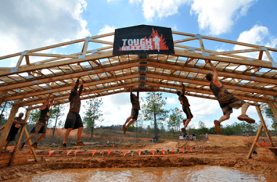 "Tough Mudder, Sydney, Australia See more in our 10 Great Races gallery When: September 22 to 23  Mud is the least of one's worries in any one of Tough Mudder's 35 events across the globe. A British Special Forces agent designed these wildly challenging 10- to 12-mile obstacle courses as the antidote to the mindless pavement pounding of typical marathons. The result is an onslaught of spine-tingling challenges, such as swimming through ice baths, swinging through buttered monkey bars, running through a field of live wires, and scaling 12-foot walls. But for every ounce of Tough Mudder's bravado, there is an equal measure of humor. Many racers wear ridiculous costumes, finish-line prizes include free Tough Mudder tattoos and mullet haircuts, and one of the official race rules is, put simply, ""no whining."" Organizers are also quick to establish that Tough Mudder is not, in fact, a race—participants are expected to help each other through obstacles. The result is an atmosphere of camaraderie that few other endurance events pull off. This year, new races are popping up in highly vacation-worthy locales, such as Sydney, London, and Vancouver. But no matter where you go, the raging postrace party is the same, with live music, free beer, medals for the fastest finishers, and awards for best costume, mullet, and Mohawk. Start Planning: Entrance ranges from $80-$150; http://toughmudder.com  Photograph by Brant Sanderlin, Tough Mudder"