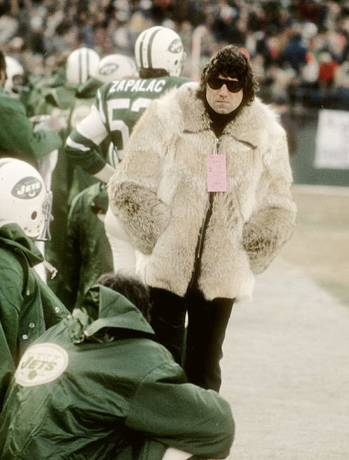 Photograph (1970) Joe Namath // New York Jets Always known for doing the impossible, Broadway Joe rocks a fur coat on the sideline of a New York Jets game circa 1970. Photo Source: SportsmansDaily.com