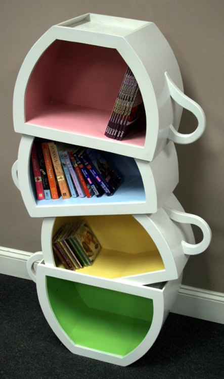 curiositycounts:  Stacked teacups, possibly the best bookshelf ever. Some close seconds.  Very Alice in Wonderland!