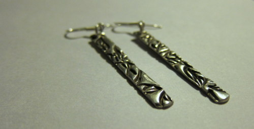 Long silver earrings… deep texture, high shine.