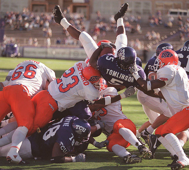 Texas Christian's LaDainian Tomlinson (5) jumps over the line of scrimmage to score a touchdown during a 1999 game against Texas El Paso. Tomlinson broke the NCAA Division I-A rushing record, gaining 406 yards and scoring six touchdowns in TCU's 52-24 victory. The Horned Frogs are in hot water after a number of players were arrested in a drug bust. (AP) SI VAULT: TCU returning to glory on coattails of Tomlinson (11.6.00)ANDERSON: Mess at TCU might get worse as more details are revealed