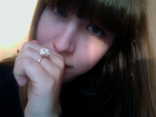 extreme closeup of my face/the fancyass ring i made  yes, that is my wisdom tooth i'm getting its more professional twin tomorrow from a jeweler. i wish i had more teeth to make more rings hahaa *~best sculpture project ever