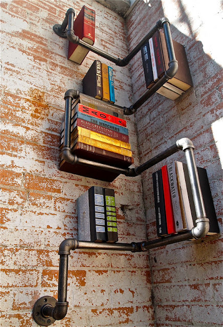 "(via TYWKIWDBI (""Tai-Wiki-Widbee""): Bookshelves crafted from industrial pipe)"