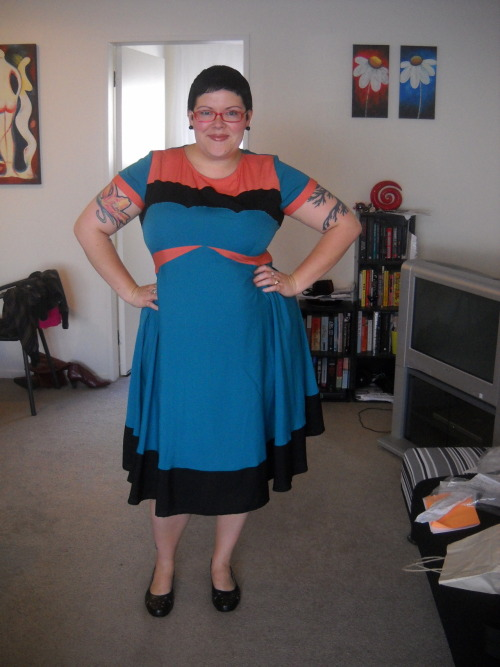 ilikeprettyclothes:  Fatshion February #18 Yesterday was a two outfit day. This was the first, what I wore to work. And I'm sporting my new pink glasses for the first time. Yay, Friday! dress - Dorothy Perkins, shoes - The Warehouse, earrings - diva