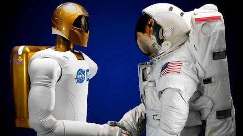 wired:  [via Fast Company] Friends at last.  Robonaut!