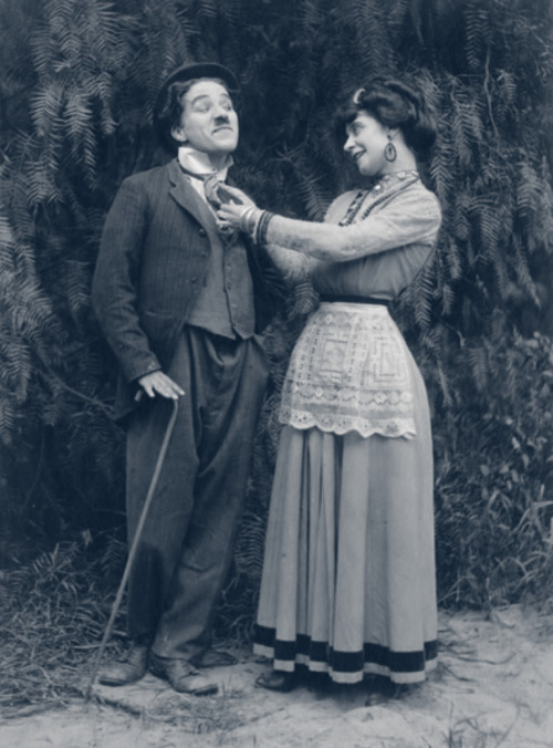 "chaplinfortheages:  Charlie Chaplin and Minta Durfee (Mrs Roscoe ""Fatty"" Arbuckle) in 1914 Keystone's ""THE STAR BOARDER"" - The tramp could be such a stud with the ladies, especially in his Keystone films."