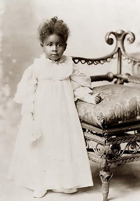 Toddlers & Tiaras | 1899 on Flickr. Full length portrait of an unidentified a young African American girl wearing a formal white princess gown with gloves. Daniel  Murray, photographer. 1899 FIND US ON TWITTER | FACEBOOK | FLICKR SUBCRIBE VIA RSS | EMAIL