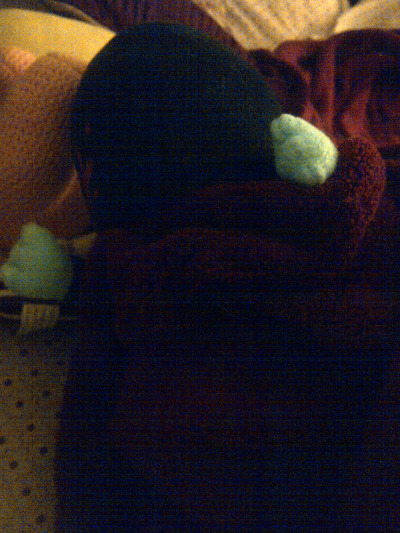 hunter!plushie hates the world and doesn't want to get out of bed. I seriously came home to find it like this, and no, it does not have batteries innit… if I want to hear unholy shrieking at night i will accidentally kick my cat off my bed.