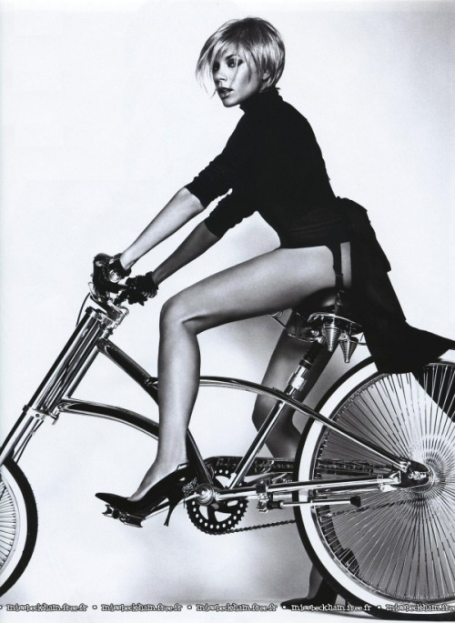 Posh spice AKA Victoria Beckham posing on a bike.