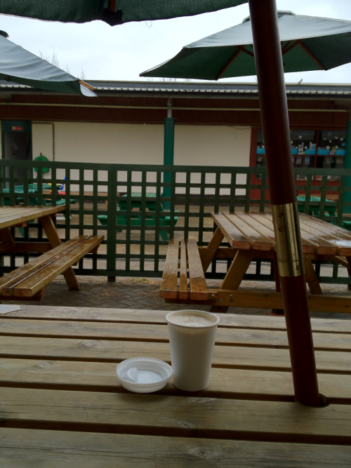 'latte & umbrella'  Raining.  Coffee at the farm.  There were biscotti but I ate them already.  Apologies. They were lovely.