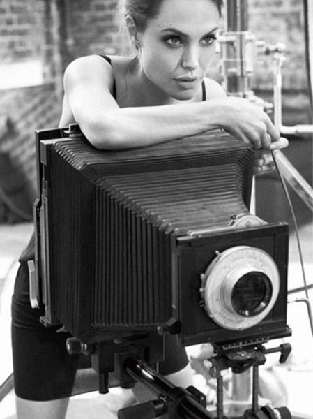 celebritycameraclub:  Angelina Jolie with a large format bellows camera
