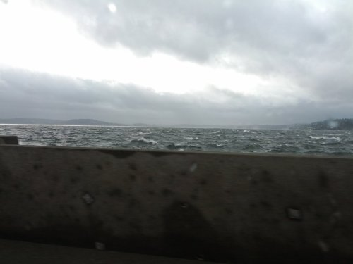 Lake Washington is pre-tty choppy right now. Waves lapping onto the 520 bridge. (Taken with picplz.)
