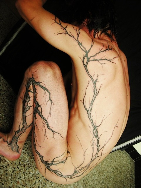 This is it! I've always wanted a tattoo with a tree that trails along the body. My family members are so against it. But I think it makes more sense than some stupid tribal symbol nobody really knows what it means.