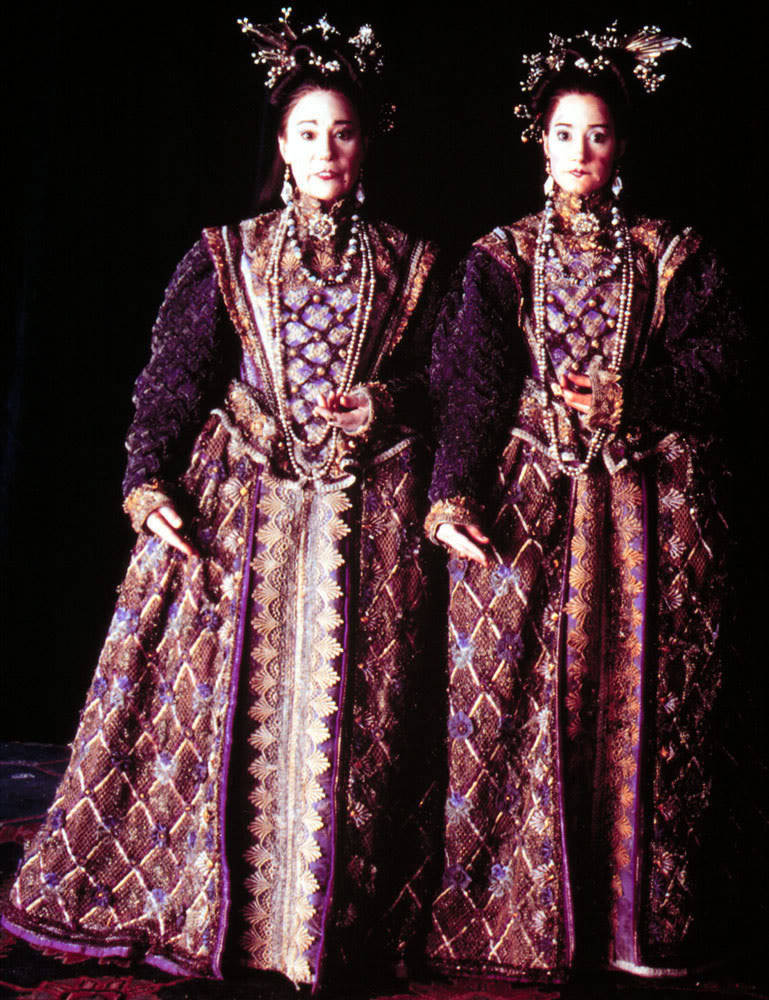 purple and gold renaissance dress Twins from Gormenghast