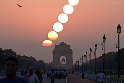 ikenbot:  Good Morning India!  by Ajay Talwar  This photo sequence has captured the rising sun above the India Gate in the heart of New Delhi. It is the country's national monument and was built in 1931.