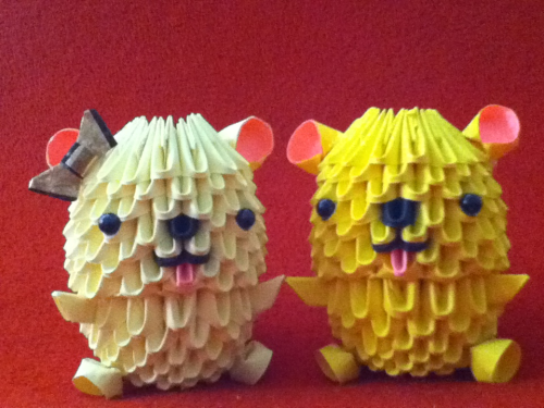 3D origami teddy bears! I added a bow to the light yellow bear to make it a girl.