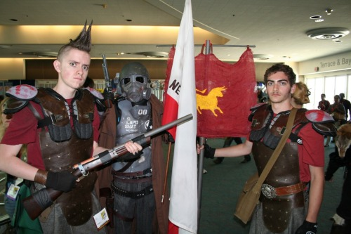 falloutgallery:  Caesar's Legion With an NCR Ranger  In Fallout: New Vegas this meet up would have resulted in a bloody battle. by Ewen and Donabel    Damn dirty Legion scum…