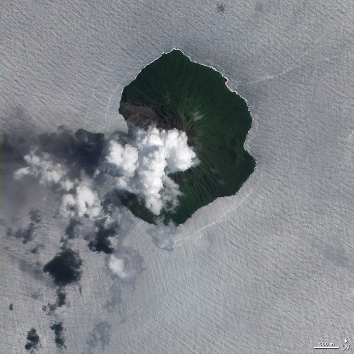Tinakula is a small, volcanic island in the South Pacific, located about 2,300 kilometers (1,400 miles) northeast of Brisbane, Australia. This natural-color satellite image (top) shows a plume of volcanic gas, possibly mixed with a bit of ash, rising above the island's summit. (via NASA Earth Observatory)