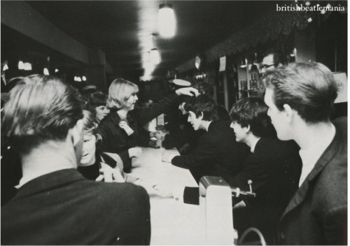 A lucky fan gets the chance to talk to the Beatles, and touch George's hair, during The Beatles Fan Club Concert, December 14, 1963. Ph: Dezo Hoffmann [x]