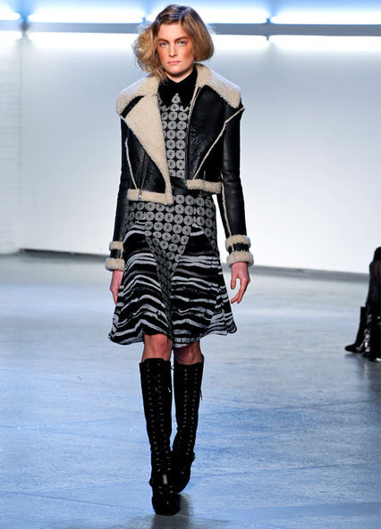 I'm smitten: This AW12 look from Rodarte, NYFW.  The high boots & little shearling jacket are gorgeous (yet, practical) foils for the flowy dress.  My favorite looks nail that perfect balance of feminine & edgy. (photo by gorunway.com)