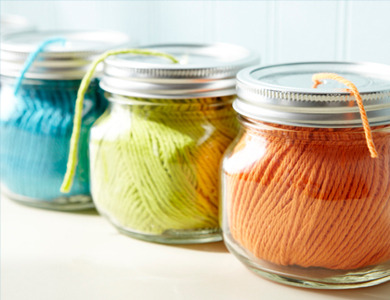 unconsumption:  Here's another jar reuse idea: Use as dispensers for yarn, string, or ribbon.  Keep spools accessible and tangle-free. With a hammer and sharp nail (or drill fitted with a small bit), pierce holes in the metal lids.   (via Home Made Simple) If you like this dispenser idea, you may want to check out this use of funnels.