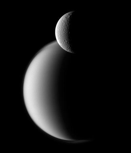saturn's moons titan and rhea.