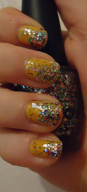 "Yellow sparkle nails on Flickr.Bright nails to lift the mood!  OPI The ""IT"" Color with Rainbow Connection atop."