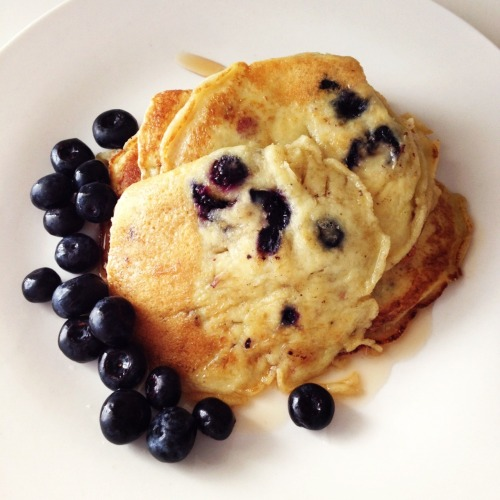 Blueberry PancakesMade some for brunch today and although pancakes are extremely simple to make and the recipe is nearly common knowledge, I still thought I'd share this idea/recipe. I know they aren't the best for shape, I'm horrible at that but maybe you guys can do better?You'll need:   1 Cup self raising flour 1 tbsp Sugar 1 Egg 3/4 cup of Milk Some butter Punnet of blueberries 2 tbsp of Strawberry Essence Golden Syrup  I think everyone knows how we begin making our pancake mix and if you really don't well it's simple and easy. Basically nearly everything goes into one mixing bowl.1. So go ahead now and add your flour, eggs, sugar, and strawberry essence all into one mixing bowl and start mixing away until the mix is smooth.2. Now put half of your blueberries into a bowl and save the other half for serving. You'll want to either cut up the blueberries in the bowl into even smaller pieces or smoosh them up with something like a fork or be manly and crush them with the might of your hands (beware of mess). Once your done, add all the blueberries and what blueberry juice you might have extracted into your pancake mix and just give the whole thing a good stir so the blueberries are all mixed in.3. Turn your stove onto a medium heat and wait for about a minute for your pan to heat up then get a butter knife and scrap some butter onto it and drop the butter smack bang in the middle of the pan. Don't spread the butter around and with a large soup or serving spoon, pour a generous scoop into the middle of the pan, on top of the butter.4. You'll notice how the mix will automatically spread nicely with the butter into a relatively good shape.With a turner, nudge at the sides of the pancake to test how much the underside as cooked and if it's ready to flip. Flip it when it's possible and when no mix comes out of the centre of the pancake after you jab it with a fork, then it's done.Repeat until you're done with all your mix and now you're ready to serve your pancakes.Serve with fresh blueberries on the side and enjoy!