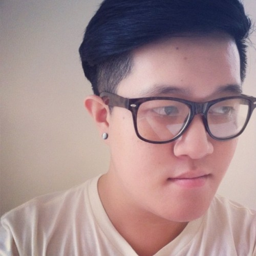 Undercut and tortoise shell specs.