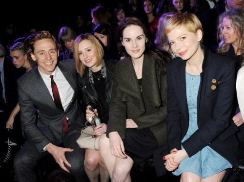 nicolasechs:  This has to be one of the most attractive front rows at a fashion show ever. Not pictured here, but also at the show, Holliday Grainger. Mulberry FW12, London Fashion Week. Via ONTD.  Can Hiddles join the cast of Downton Abbey and play the man who comes along and finally realizes that Edith is AWESOME and is actually worthy of basking in her AWESOME so that they can fall in love and be the actual best thing to ever happen ever?  Please?
