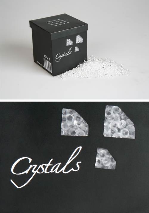 "Packaging I designed for ""Crystals"" diamond shaped sugar. The idea was to add original value and re-brand an everyday item, mine sugar. I came up with extra strength diamond shaped sugar. It would have the equivalent strength of 2tsp of ordinary white sugar in each diamond and with a longer lasting taste. It is aimed at women in their 40's who like to live glamorously and want to stay slim without sacrificing taste! This is the logo I made for my Crystals brand."